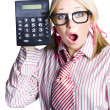 Businesswoman with calculator — Stock Photo
