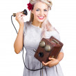 Woman using antique telephone - Stock Photo