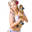 Woman in bikini holding skateboard — Stock Photo