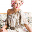Blonde woman in curlers - Stock Photo