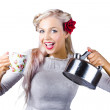 Pinup girl holding kettle and mug - Stock Photo