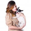 Young woman holding dog - Stock Photo