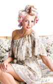 Blonde woman in curlers — Stockfoto