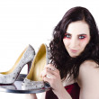 Pretty woman selling shoes on silver plate - Stock Photo