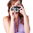 Surprised woman taking picture with old camera — Stock Photo