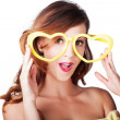 Funny woman with heart shape sunglasses — Photo