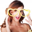 Funny woman with heart shape sunglasses — Stockfoto