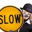 Royalty-Free Stock Photo: Funny business woman with slow sign