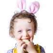 Boy eating Easter egg — Stockfoto
