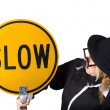 Woman in black holding yellow slow sign — Stock Photo