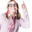 Brainy business woman pointing to copyspace — Stock Photo