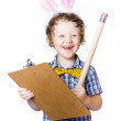 Boy writing Easter list — Stock Photo