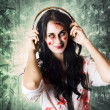 Gothic rock music girl wearing headphones - Photo