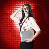 Zombie business woman in red alert emergency — Stock Photo
