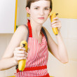 Royalty-Free Stock Photo: Dietician shooting banana guns in kitchen