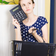 Woman planning shopping budget with calculator - Zdjęcie stockowe