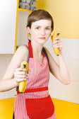 Dietician shooting banana guns in kitchen — Stock Photo