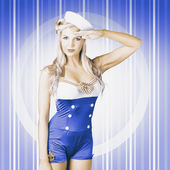 American pinup poster girl in military uniform — Stock Photo