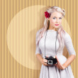 Creative vintage woman holding retro camera - Stock Photo