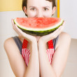 Funny woman with juicy fruit smile — Stock Photo
