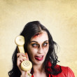 Funny zombie employee with dead phone line - Stock Photo