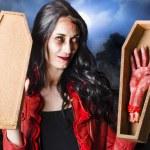 Female Halloween zombie holding undead hand — Stock Photo
