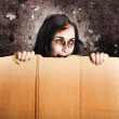 Scary zombie girl advertising halloween price cut - Stockfoto