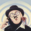 Vintage futurist using phone on time warp backdrop - Foto Stock