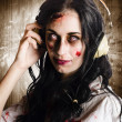 Hard rock zombie listening to death metal music — Stock Photo
