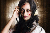 Hard rock zombie listening to death metal music — Stok fotoğraf