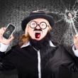 Stock Photo: Business mwith cracked mobile phone screen