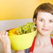 Lovely young woman holding bowl of fruit salad - Stock Photo