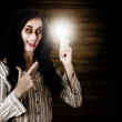 Zombie girl holding lightbulb with bad idea — Stock Photo