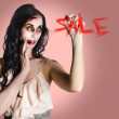 Frightening businesswoman writing sale in blood — Stock Photo