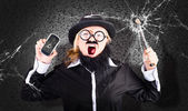 Business man with cracked mobile phone screen — Stockfoto