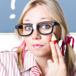 Cute blond girl in glasses asking big question - Foto Stock