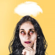 Stock Photo: Dead zombie business wombrainstorming idea
