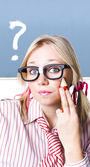 Cute blond girl in glasses asking big question — Stok fotoğraf