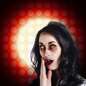 Dark portrait of a zombie girl in shock horror — Stock Photo
