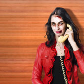 Zombie call centre worker cold calling on phone — Stock Photo