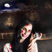 Spooky girl with silver service bell in graveyard — Stock Photo