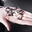 Man displaying a selection of stylish rings — Stock Photo