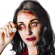 Zombie woman holding flashlight on white - Stockfoto