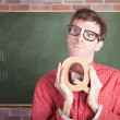 Smart male school teacher with education question - Stockfoto