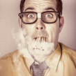 Smoking nerd businessman under work stress -  