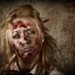 Evil grunge zombie business woman thinking idea - Stock Photo