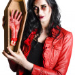 Zombie Woman with Coffin and Severed Hand — Stock Photo