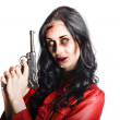 Killer female zombie with hand pistol — Stock Photo