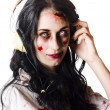 Heavy metal zombie woman wearing headphones - Stok fotoğraf