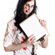Zombie business woman with clip board - Stock Photo